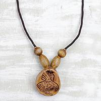 Wood pendant necklace, 'Somemu' - Engraved Sese Wood Bird Beaded Pendant Necklace
