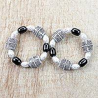 Recycled glass and plastic beaded stretch bracelets, 'Alewa' (pair) - Black and White Recycled Beaded Stretch Bracelets (Pair)