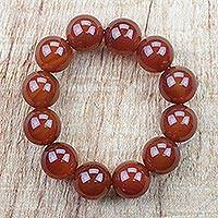 Recycled glass beaded stretch bracelet, 'Chestnut Beauty' - Chestnut Brown Eco-Friendly Recycled Glass Beaded Bracelet