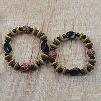 Recycled glass beaded stretch bracelets, 'Quiet Dignity' (pair) - Multi-Colored Sese Wood and Recycled Glass Beaded Bracelet