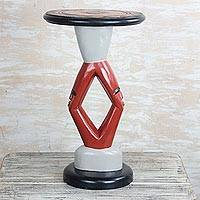 Cedar wood accent table, 'Red Faces' - Hand-Carved Cedar Wood Accent Table from Ghana