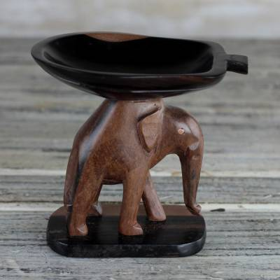 Ebony wood mini catchall, Elephant Carrying a Leaf' - Handcrafted Ebony Wood Elephant Mini Catchall from Ghana