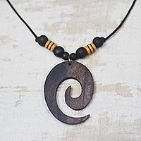 Ebony wood pendant necklace, 'Glorious Spiral' - Ebony Wood Spiral Motif Pendant Necklace from Ghana