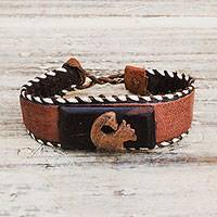 Ebony wood and leather pendant bracelet, 'Charming Sankofa' - Ebony Wood and Leather Adinkra Pendant Bracelet from Ghana