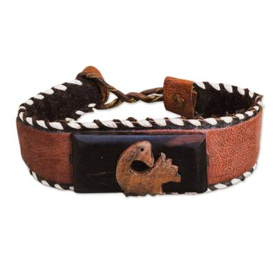 Ebony wood and leather cuff bracelet, 'Charming Sankofa' - Ebony Wood and Leather Adinkra Cuff Bracelet from Ghana
