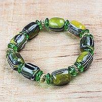 Recycled plastic beaded stretch bracelet, 'Eco Green' - Recycled Plastic Beaded Stretch Bracelet in Green from Ghana