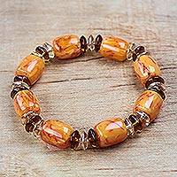 Recycled plastic beaded stretch bracelet, 'Sisterly Love' - Recycled Plastic Beaded Stretch Bracelet in Orange