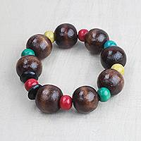 Wood beaded stretch bracelet, 'Joyful Together' - Brown and Multi-Color Wood Bead Stretch Bracelet from Ghana