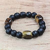Tiger's eye beaded bracelet, 'Substance' - Tiger's Eye Matte Black Recycled Glass Bead Stretch Bracelet
