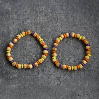 Wood beaded stretch bracelet, 'Colors of Romance' - Colorful Sese Wood Beaded Stretch Bracelet from Ghana