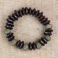 Wood and recycled plastic beaded stretch bracelet, 'Remembering Passion' - Brown Wood and Recycled Plastic Bracelet from Ghana