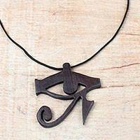 Ebony wood pendant necklace, 'Egyptian Eye' - Ebony Wood Egyptian Eye Pendant Necklace from Ghana