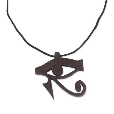 Ebony wood pendant necklace, 'Egyptian Eye' - Ebony Wood Egyptian Eye Pendant Necklace from Ghana