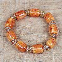 Recycled glass and plastic beaded stretch bracelet, 'Graceful Fire' - Recycled Glass and Plastic Beaded Stretch Bracelet in Orange