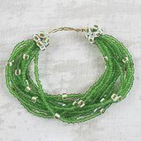 Recycled glass and plastic beaded torsade bracelet, 'Flowing Green Rivers' - Green Striped Recycled Plastic and Glass Beaded Bracelet