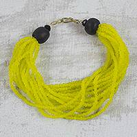 Recycled glass beaded torsade bracelet, 'Divine Yellow' - Handmade Yellow and Black Recycled Glass Beaded Bracelet