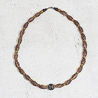Recycled beaded necklace, 'Tortoise Glyph' - Recycled Plastic and Wood Beaded Necklace from Ghana