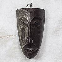 African wood mask, 'Solemn Hunter' - Handcarved Antiqued Sese Wood Wall Mask from West Africa