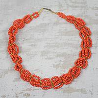 Beaded necklace, 'Orange Serenity' - Recycled Orange Plastic Woven Lace Statement Necklace