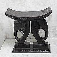 Wood stool, 'Elephant Carriers' - Elephant-Themed Sese Wood Stool from Ghana