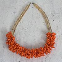 Recycled plastic beaded necklace, 'Me Na Ye' - Orange and Gold Recycled Plastic Beaded Necklace from Ghana