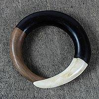 Ebony and bone bangle bracelet, 'Bold Curve' - Hand Carved Ebony Wood and Cow Bone Bangle Bracelet