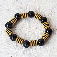 Recycled plastic bead stretch bracelet, 'Modern Buzz' - Bold Black and Yellow Striped Recycled Bead Stretch Bracelet