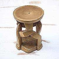 Wood decorative stool, 'Fantastic Forms' - Artisan Crafted Cedar Wood Decorative Stool from Ghana