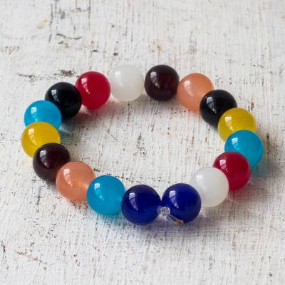 Glass beaded stretch bracelet, 'Rainbow Nkunim' - Colorful Recycled Glass Beaded Stretch Bracelet from Ghana
