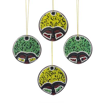 Recycled plastic beaded wood ornaments, 'Ashanti Faces' (set of 4) - Recycled Plastic Beaded Wood Ornaments from Ghana (Set of 4)