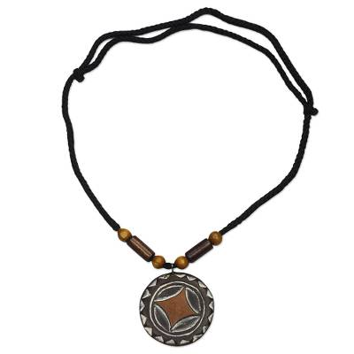 Wood pendant necklace, 'African Star' - Star Pattern Sese Wood Pendant Necklace from Ghana