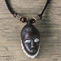 Wood and recycled plastic pendant necklace, 'Baule Portrait' - Baule-Inspired Sese Wood Pendant Necklace from Ghana