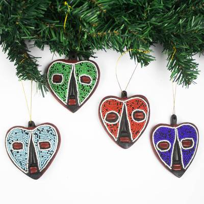 Wood and recycled glass bead ornaments, 'Eternal Love' (set of 4) - Heart-Shaped Sese Wood Holiday Ornaments (Set of 4)