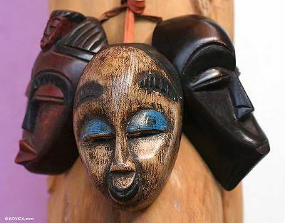 Wood ornaments, 'Be Happy' (set of 3) - African Mask Christmas Ornaments (Set of 3)