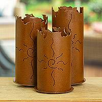 Iron wall candleholder, 'Sun Spirals' - Artisan Crafted Rustic Steel Candle Holder