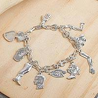 Sterling silver charm bracelet, 'Little Miracles' - Silver Charm Bracelet with Body Chamrs