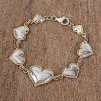 Gold accented sterling silver charm bracelet, 'Hearts' - Gold Accented Heart Charm Bracelet