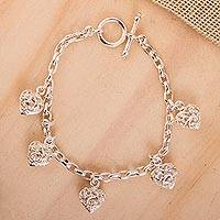 Featured review for Sterling silver charm bracelet, Wild Hearts
