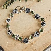Peridot charm bracelet, 'Hypnotize' - Handmade Taxco Sterling Peridot Bracelet