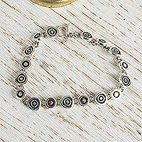 Sterling silver charm bracelet, 'Hypnotize'