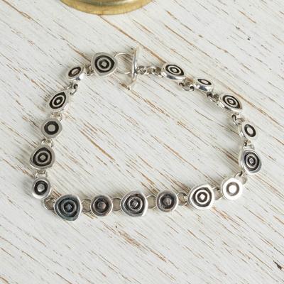 Sterling silver charm bracelet, 'Hypnotize' - Handmade Sterling Silver Link Bracelet