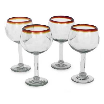 Blown glass wine glasses, 'Amber Globe' (set of 4) - Fair Trade Handblown Glass Recycled Wine Glasses Set of 4