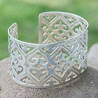 Sterling silver cuff bracelet, 'Hearts Encounter' - Taxco Silver Wide Cuff Bracelet Sterling 925 from Mexico