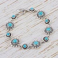 Turquoise flower bracelet, 'Aztec Star' - Artisan Crafted Silver and Natural Turquoise Bracelet