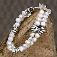 Pearl beaded bracelet, 'Silver Ribbon Bows' - Fair Trade Pearl and Sterling Silver Bracelet from Mexico