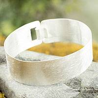 Sterling silver bangle bracelet, 'Olmec Fusion' - Sterling silver bangle bracelet