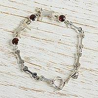 Garnet link bracelet, 'Pampered Puppy Dog' - Handcrafted  Sterling Silver and Garnet Doggie Bracelet