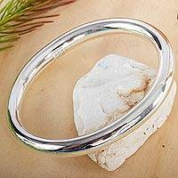 Sterling silver bangle bracelet, 'Oval Halo'