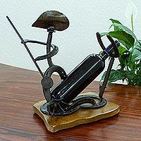 Upcycled horseshoe bottle holder with shot glass,