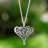 Sterling silver heart pendant necklace, 'Heartful' - Sterling Silver Love Pendant Necklace from Mexico